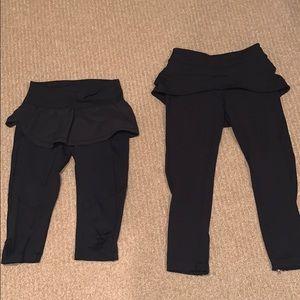 Two pairs of black lulu leggings w/ skirt overtop